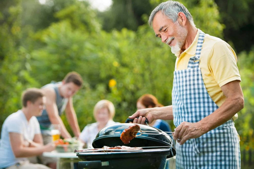 The suburban dad grilling for his family
